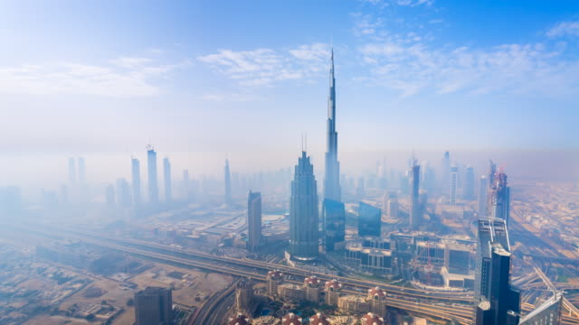 ws dubai skyline in the fog at dawn - international landmark stock videos & royalty-free footage