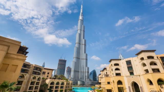tl ws dubai skyline with souk al bahar and dubai fountain - burj khalifa stock videos & royalty-free footage