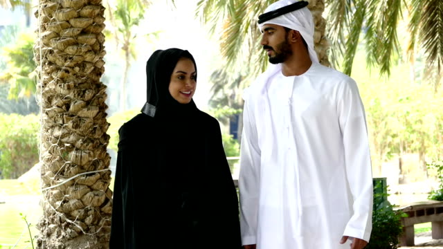 Dubai - Traditional Emirati young couple outside