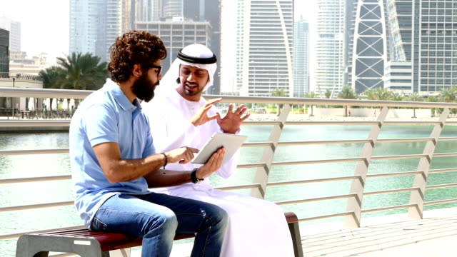 Dubai - Young people using digital tablet in the city - Stock video