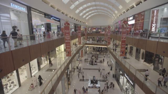 dubai_mall_open_shopping_tv - western script stock videos & royalty-free footage