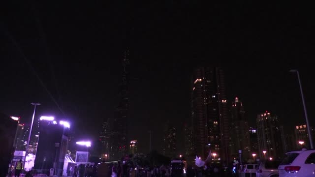 dubais burj khalifa along with other landmarks across the globe dimmed its lights on saturday night for the 10th edition of the earth hour campaign... - earth hour stock videos & royalty-free footage