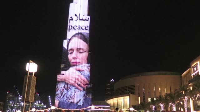 dubai's burj khalifa tower was lit up with an image of new zealand prime minister jacinda ardern on saturday night in tribute to her response to the... - prime minister stock videos & royalty-free footage
