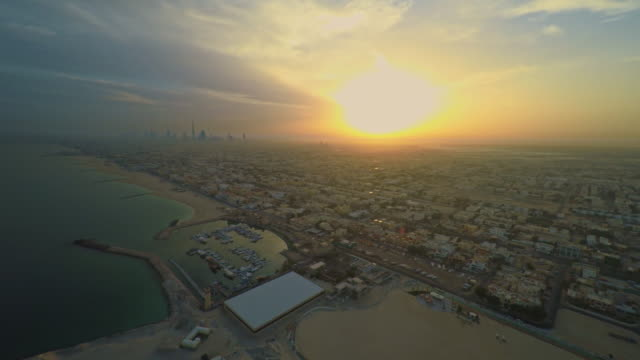 aerial dubai's coastline at sunset - aircraft point of view stock videos & royalty-free footage