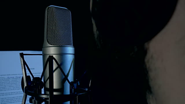 dubbing artist in the recording studio - microphone stock videos and b-roll footage