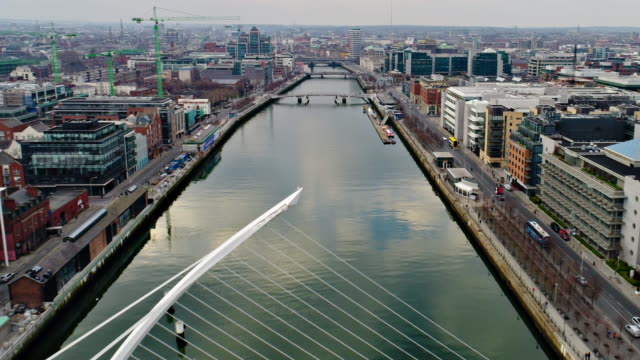 dublin ireland flying over river liffey towards town center - bridge built structure stock videos and b-roll footage