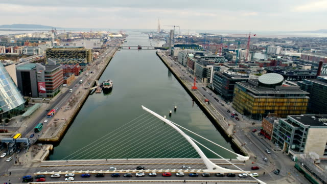 dublin ireland flying over river liffey towards town center - dublin ireland stock videos and b-roll footage