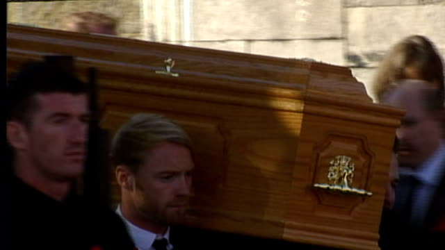 dublin sheriff street ext coffin of stephen gately carried along from church by other members of boyzone general views of crowd outside church - ronan keating stock videos & royalty-free footage