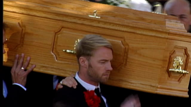 dublin sheriff street ext coffin of stephen gately carried along from church by other members of boyzone mourners outside church - ronan keating stock videos & royalty-free footage
