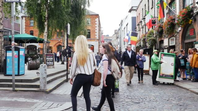 dublin street scene in temple bar square - dublin ireland stock videos and b-roll footage