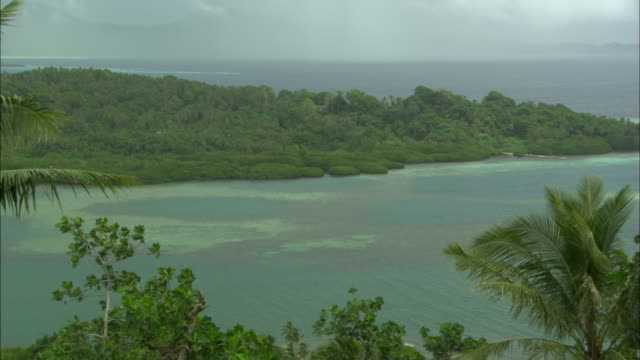 dublon island with jungle and ocean, chuuk lagoon, south pacific  - south pacific ocean stock videos and b-roll footage