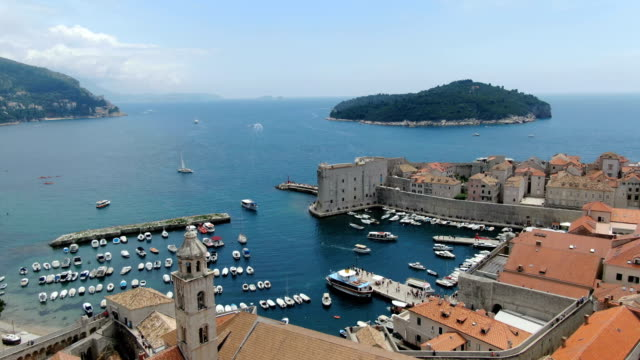 dubrovnik aerial flying above harbour, historic town in dalmatia region of croatia - croazia video stock e b–roll