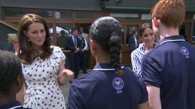 duchess of cambridge and duchess of sussex, kate and meghan, meet ball boys an girls at wimbledon tennis tournament - boys stock videos & royalty-free footage