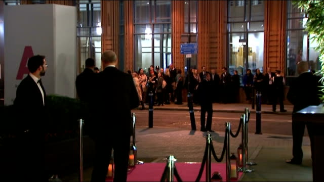 Duchess of Cambridge arrives for gala dinner ENGLAND London THROUGHOUT **** People arriving / Traffic along past red carpet / Police outriders along...