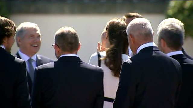 Duchess of Cambridge at reception for America's Cup Duchess meeting guests in lineup / / Kate meeting man holding little children and being given...