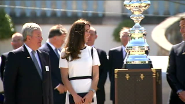 Duchess of Cambridge at reception for America's Cup ENGLAND London Greenwich EXT GVs Catherine Duchess of Cambridge walking along with Sir Keith...