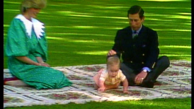 Duchess of Cambridge gives birth to boy File 1983 Auckland Government House Various shots Prince Charles and Princess Diana sat on rug in gardens...