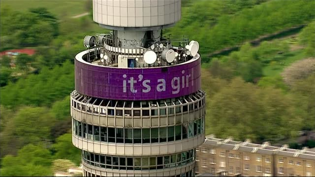 aerials of st mary's hospital bt tower and buckingham palace air views london skyline / bt tower with digital message 'it's a girl' scrolling along... - it's a girl stock videos & royalty-free footage