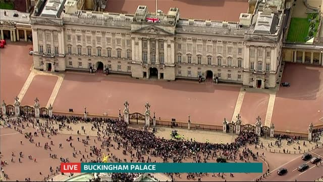Announcement and reactions CUTAWAY AIR VIEW AERIAL of crowds outside Buckingham palace