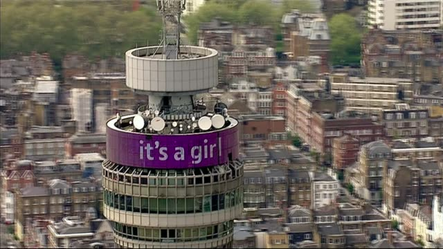 itv news special cf air view bt tower with illuminated 'it's a girl' message in purple - it's a girl stock videos & royalty-free footage