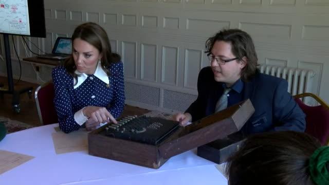 vidéos et rushes de duchess of cambridge has a go on a code breaking machine druing visit to bletchley park - casser les codes