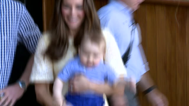 duchess of cambridge holding prince george beside bilby enclosure at taronga zoo in sydney during royal visit - 2014 stock videos & royalty-free footage