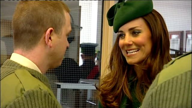 Duchess of Cambridge presents shamrocks to the Irish Guards INT Soldiers sat at long tables some wearing St Patrick's Day hats and drinking beer /...