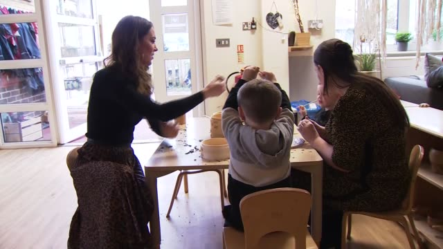 duchess of cambridge visits childrens centre; wales: cardiff: ely: int catherine, duchess of cambridge along and talking to staff / various shots of... - polo neck stock videos & royalty-free footage