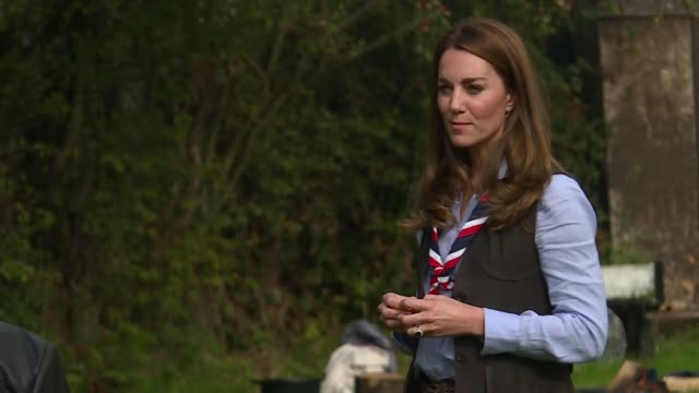 duchess of cambridge visits cub and beaver scouts england london northolt ext catherine duchess of cambridge roasting marshmallows on bonfire and... - cub stock videos & royalty-free footage