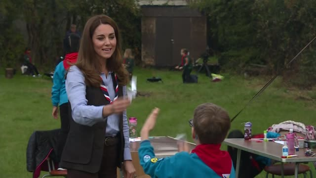 duchess of cambridge visits cub and beaver scouts; england: london: northolt: ext catherine, duchess of cambridge along in field then being... - young animal stock videos & royalty-free footage
