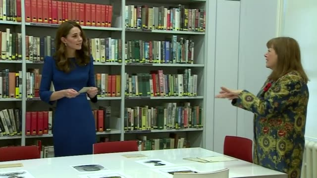 duchess of cambridge visits imperial war museum; england: london: lambeth: imperial war museum: catherine, duchess of cambridge in library looking at... - lambeth stock videos & royalty-free footage