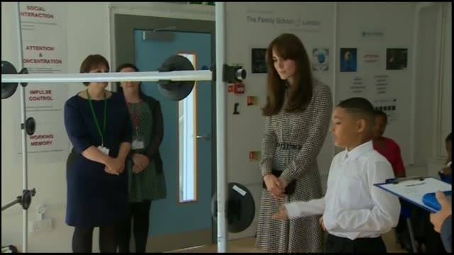 duchess of cambridge visits the family school london; kate chatting to children / kate putting on 3d glasses and watching display / kate and boy... - co ordination stock videos & royalty-free footage