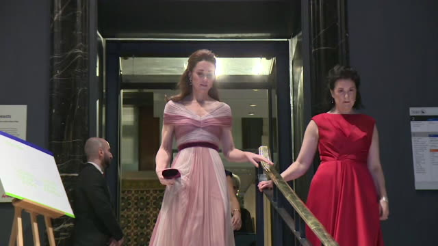 duchess of cambridge walks downstairs and into va gala event for 100 women in finance wearing glamorous pink dress - gala stock videos & royalty-free footage