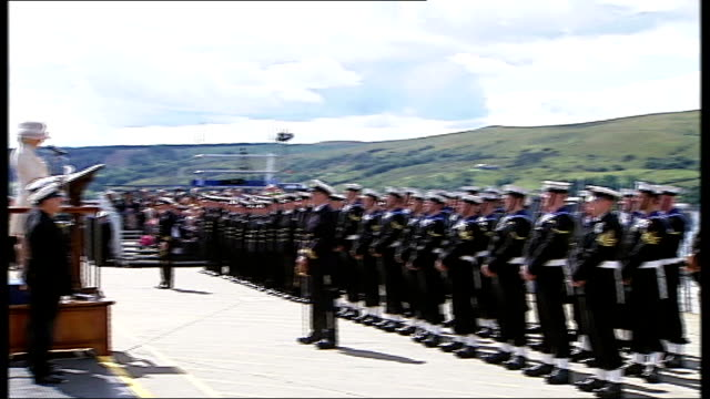 duchess of cornwall attends hms astute commissioning ceremony; duchess of cornwall along to podium and addressing sailors sot - it an enormous... - no doubt band stock videos & royalty-free footage