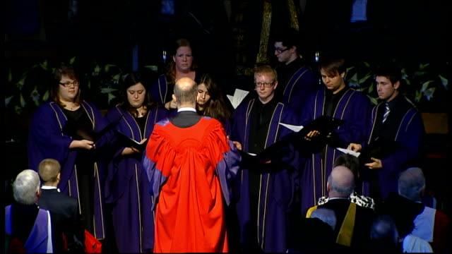 duchess of cornwall installed as chancellor of aberdeen university; **music heard sot** king's college choir along down aisle / choir singing - choir stock videos & royalty-free footage