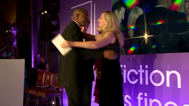 duchess of cornwall presents man booker prize for fiction beatty collecting award from camilla / camilla posing with beatty and others on stage - man booker prize stock videos & royalty-free footage