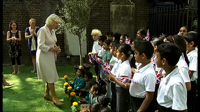 duchess of cornwall visits community gardens in east london general view of camilla chatting to children / more of camilla looking at garden the... - saucer stock videos & royalty-free footage