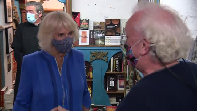 duchess of cornwall visits hay-on-wye festival of literature and arts; wales: powys: hay-on-wye: int gvs camilla along into shop and greeting book... - talking stock videos & royalty-free footage
