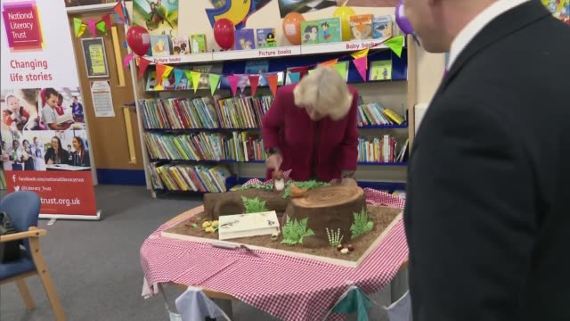 Duchess of Cornwall visits North Swindon Library listens to children's story presents certificates and cuts cake ENGLAND Wiltshire Swindon North...