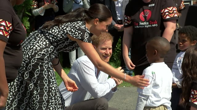 duchess of sussex gets hug of little boy as her and prince harry visit nyanga township in cape town as part of their africa tour - affectionate stock videos & royalty-free footage