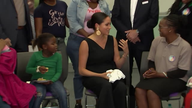 duchess of sussex giving mothers some of archie's old baby clothers during visit to mothers2mothers charity in cape town during the africa tour - gift stock videos & royalty-free footage