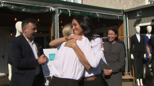 duchess of sussex hugs her friend misha nonoo at the launch of her smart works fashion collection the smart set - friendship stock videos & royalty-free footage