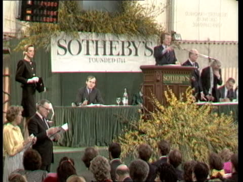 geneva beau rivage hotel ms auctioneer ms member of sotheby's staff displays cufflinks cms auctioneer video ex eng/itn obit via ssr - cufflink stock videos & royalty-free footage