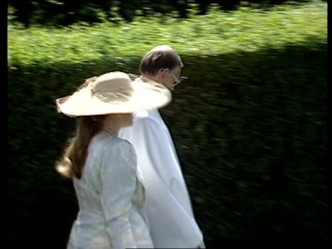 highland games; itn england: gloucestershire: great rissington: ext tms duchess of york towards chatting to vicar pull out walking across church yard... - ヨーク公爵夫人点の映像素材/bロール