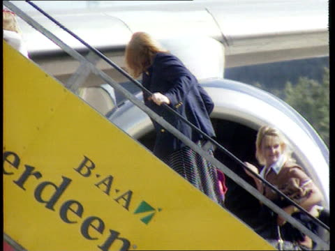 duchess of york leaves balmoral / diana tapes; a) scotland: balmoral: ext airv balmoral castle track r-l sarah, duchess of york as driving away in... - ヨーク公爵夫人点の映像素材/bロール