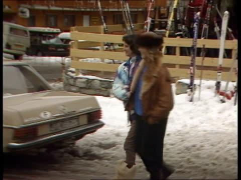 duchess of york skis in meribel duskcms terry lloyd i/c sof sarah woman out shop carefully treading along on snow pan rl away to bv cms side sarah... - meribel stock videos & royalty-free footage