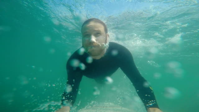 duckdive - surfboard stock videos and b-roll footage