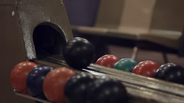 duckpin bowling balls in return machine - bowling ball stock videos & royalty-free footage