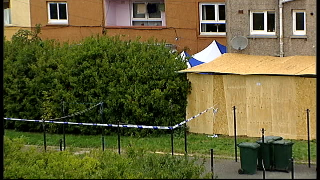 cordoned off and boarded up area at back of houses where human remains believed to be those of samantha wright were found police officer on guard... - human back stock videos & royalty-free footage