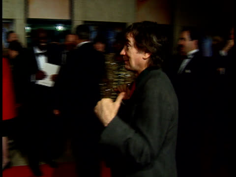 stockvideo's en b-roll-footage met a night to fight diabetes dudley moore walks on the red carpet - dudley moore